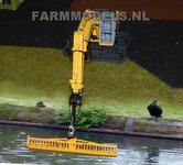 919.-Verlenggiek-met-snelwisselset-en-Herder-maaibord-voor-New-Holland-rupskraan