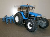 545.-New-Holland-8770A-op-bredere-banden-met-bouwkit-cultivator-Lemken-Evers