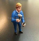81038-Boer-monteur-met-hamer-en-beitel-(blauwe-overall)--Monteur-boer-loonwerker--Handgeschilderd-model-1:32-(POP)