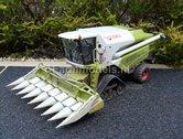 408.--Claas-Tucano-op-rupsen-met-kolvenplukker-en-vervuilde-look